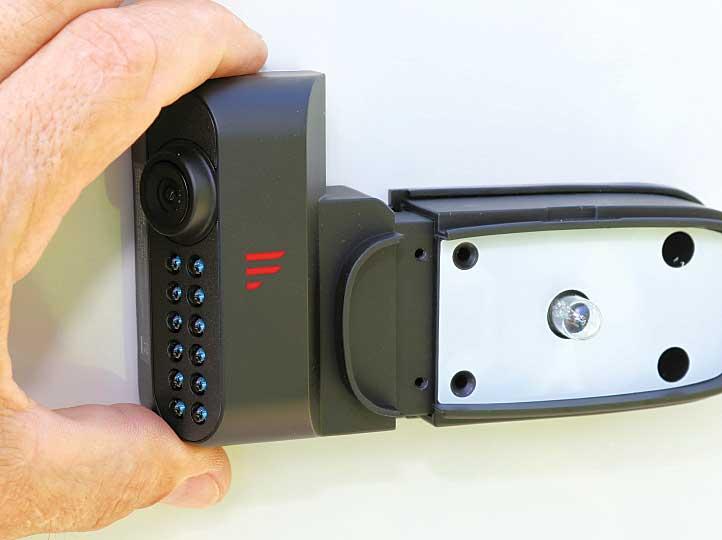 Technisian slides the camera onto the camera-mount stub.