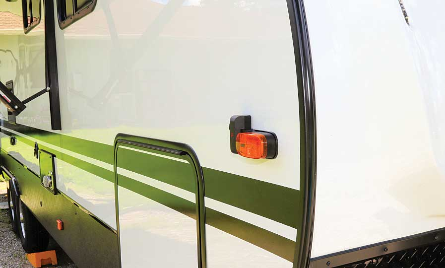 Photo shows right marker-light camera in place almost at eye level.
