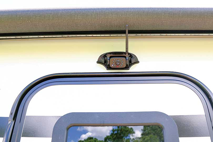 Photo shows the batwing-style multiposition camera in place over the entry door.