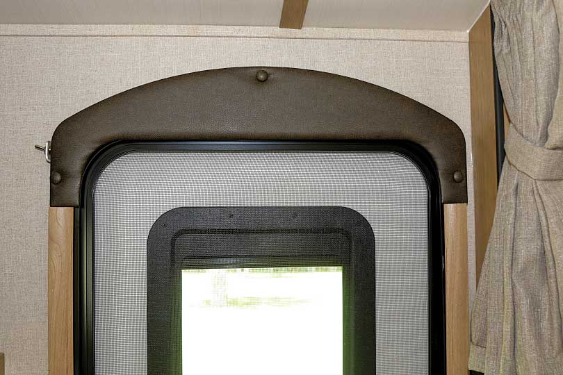 Photo shows the doorway arch and trim back in place with only a slight hint of the switch visible on the side.
