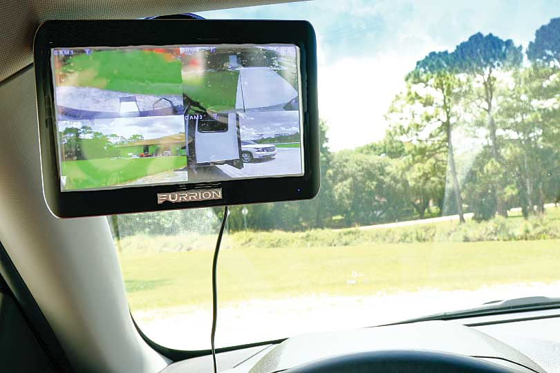 Photo shows the monitor mounted to the tow-vehicle windshield using the suction-cup bracket.