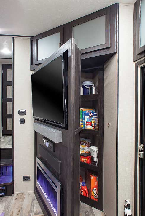 Utilizing the corner space behind the entertainment center and electric fireplace, the Fuzion 424 incorporates a hidden pantry.