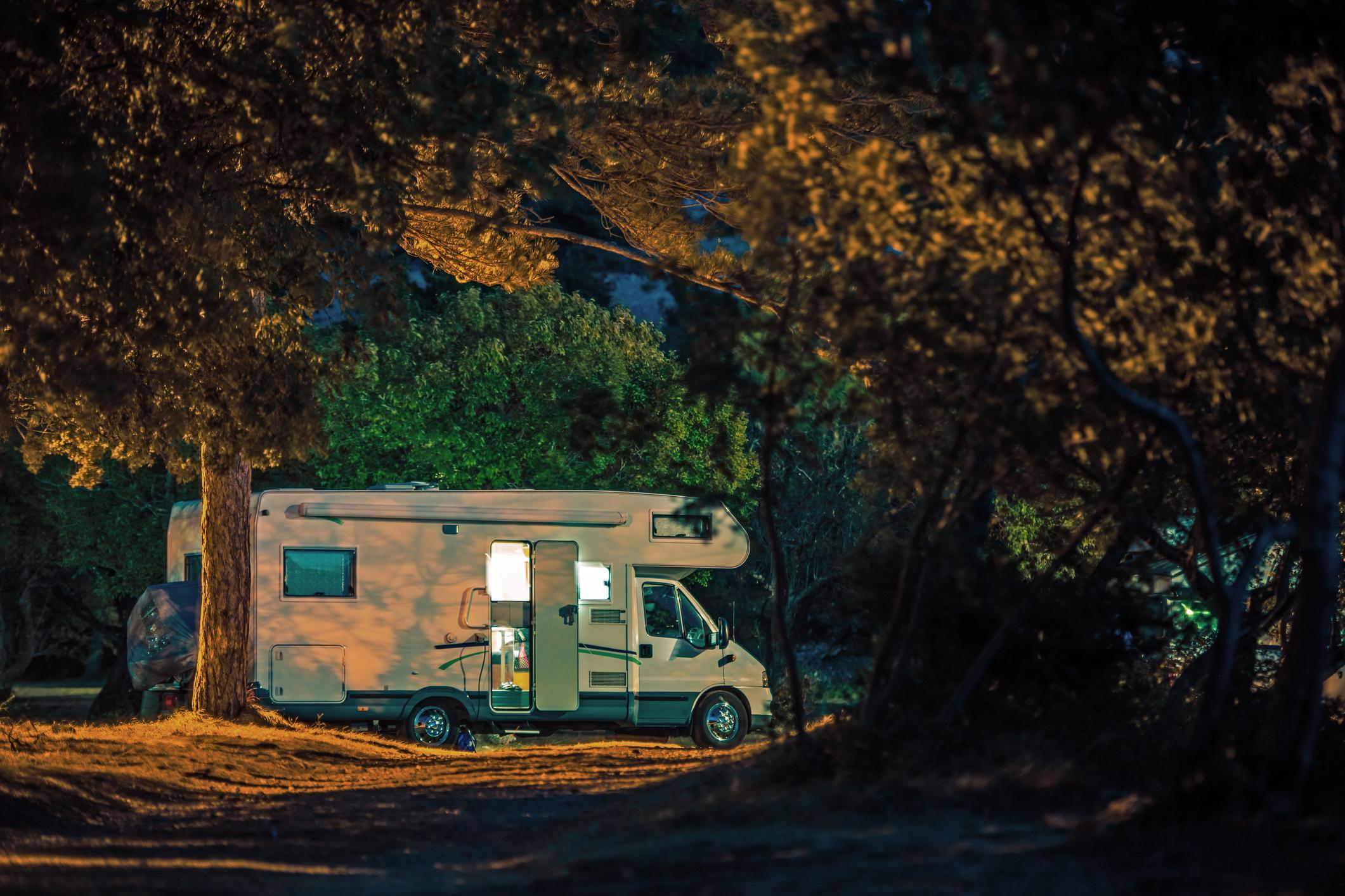 Motorhome Vacation Travel. Calm Camping Night inside RV Camper Van.