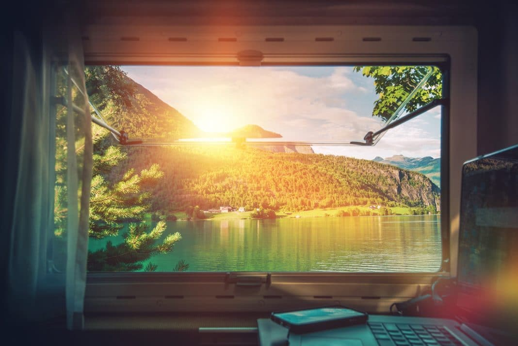 Work desk with scenic mountain views, while traveling inside RV motorcoach