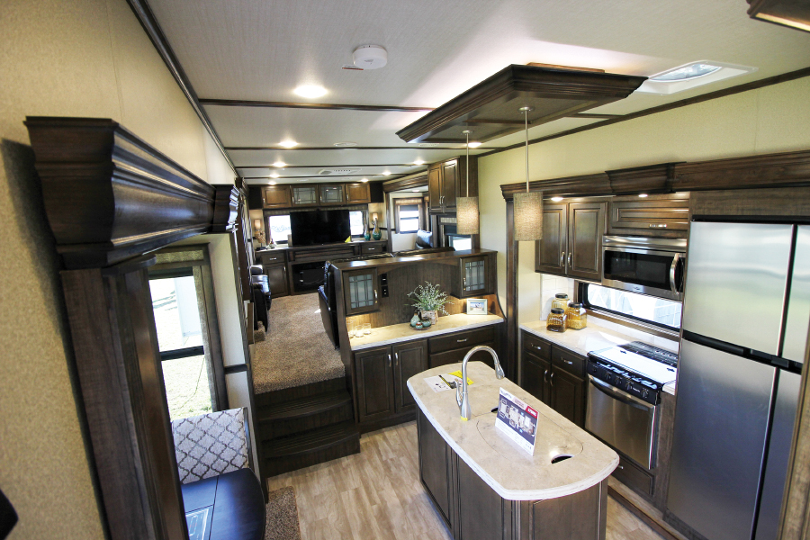 RV living space with kitchen island and refrigerator