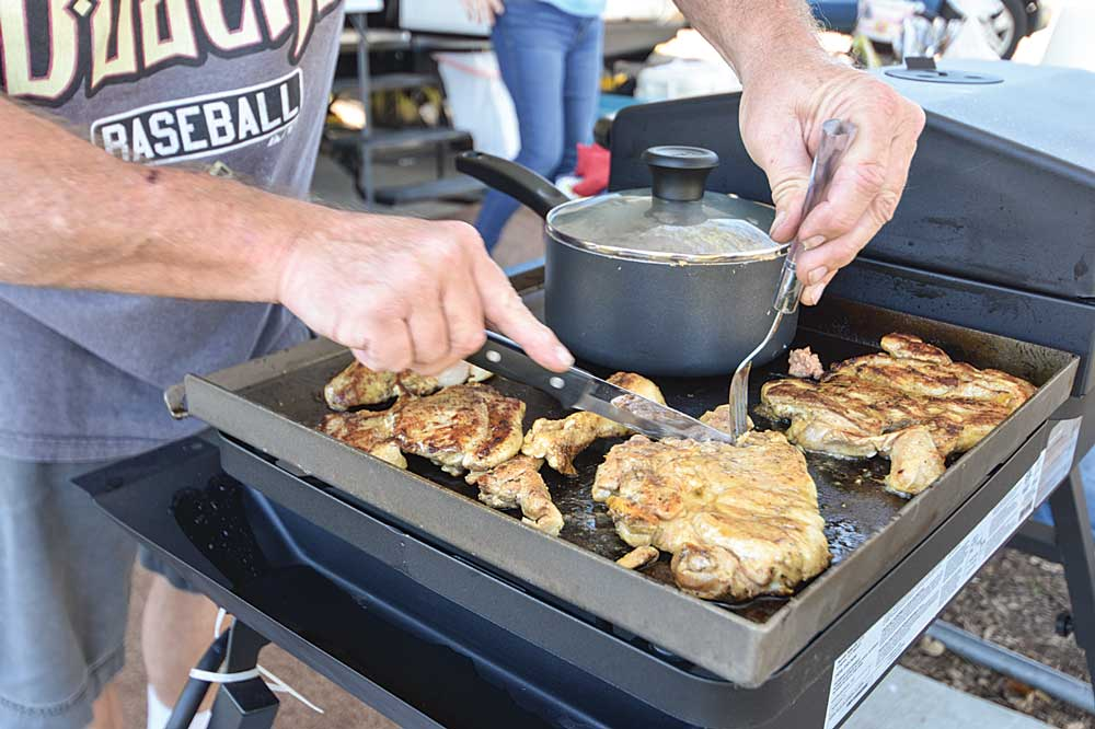 Preparing beef and chicken tacos on an outdoor grill