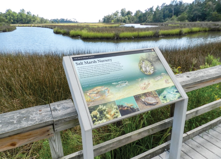 Visitors to the Davis Bayou can learn about the area through informative plaques along the eponymous trail.