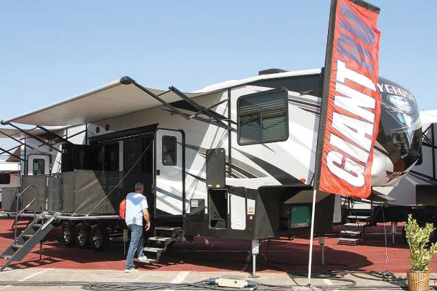 Cyclone 4270 RV with man walking up stairs