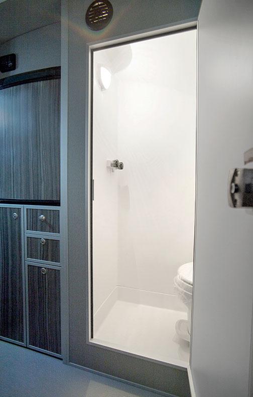 Door to enclosed shower open inside trailer.