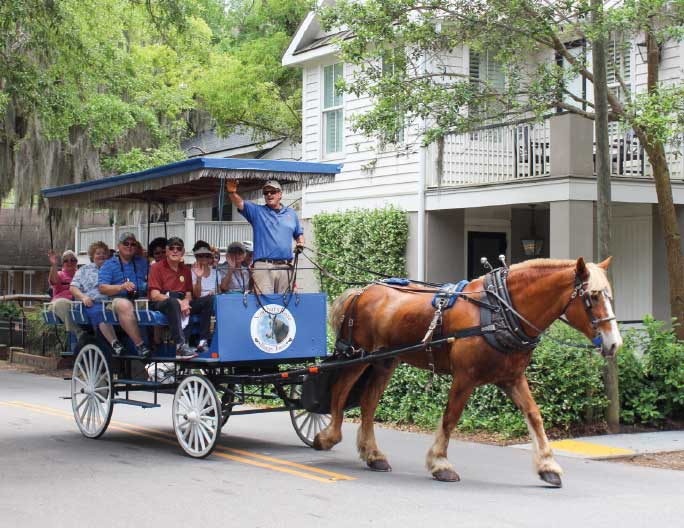 A horse-drawn carriage tour is a great way for visitors to see many of the town's older homes and structures.