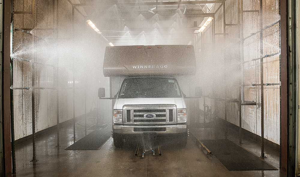 Afinished motorhome undergoes a high-pressure water test, with 250 spray holes simulating 50 inches of rain per hour.