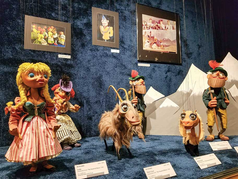 """The Sound of Music's """"The Lonely Goatherd"""" puppets, created by master puppeteer Bil Baird, on display at the MacNider Art Museum."""