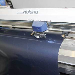Once an entire roll of vinyl is loaded into the cutting machine, all the new pieces for individual colors are produced. This is a precise process that has no room for errors.