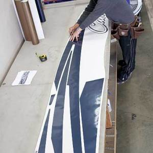 """The """"weeding and taping"""" process is used to prep the new vinyl prior to installation. This process is critical and requires great patience."""