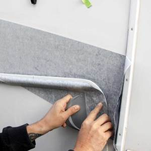 A special tool is used to fit the new vinyl into curves and moldings. This also takes many years of experience to do it right.