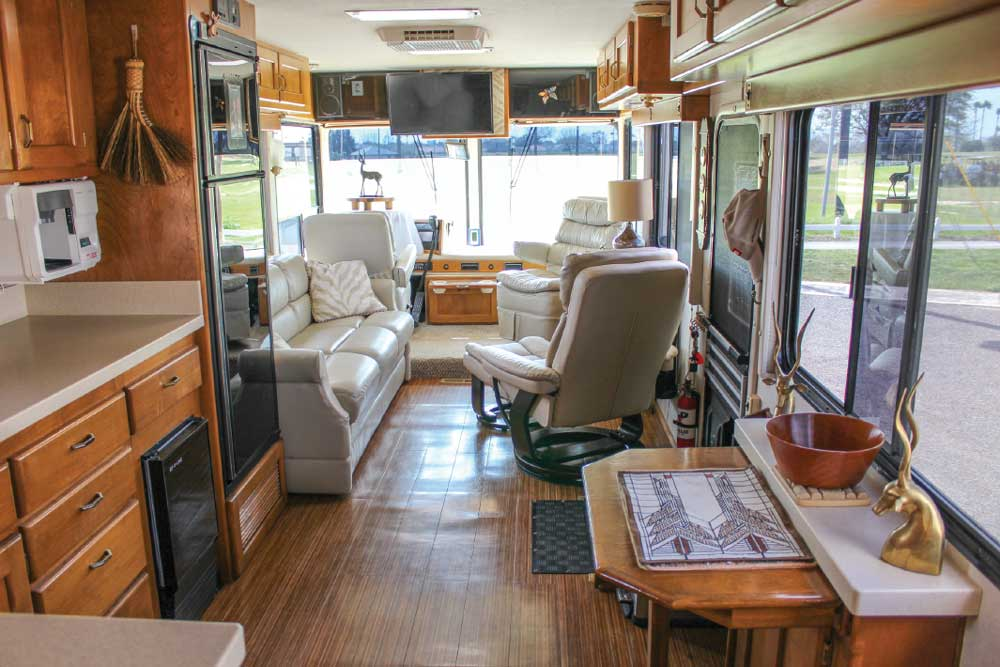 This Safari sports a new HDTV and Bose sound system. The new, white recliner and sofa, along with the reupholstered captain's chairs, brighten the coach's interior.