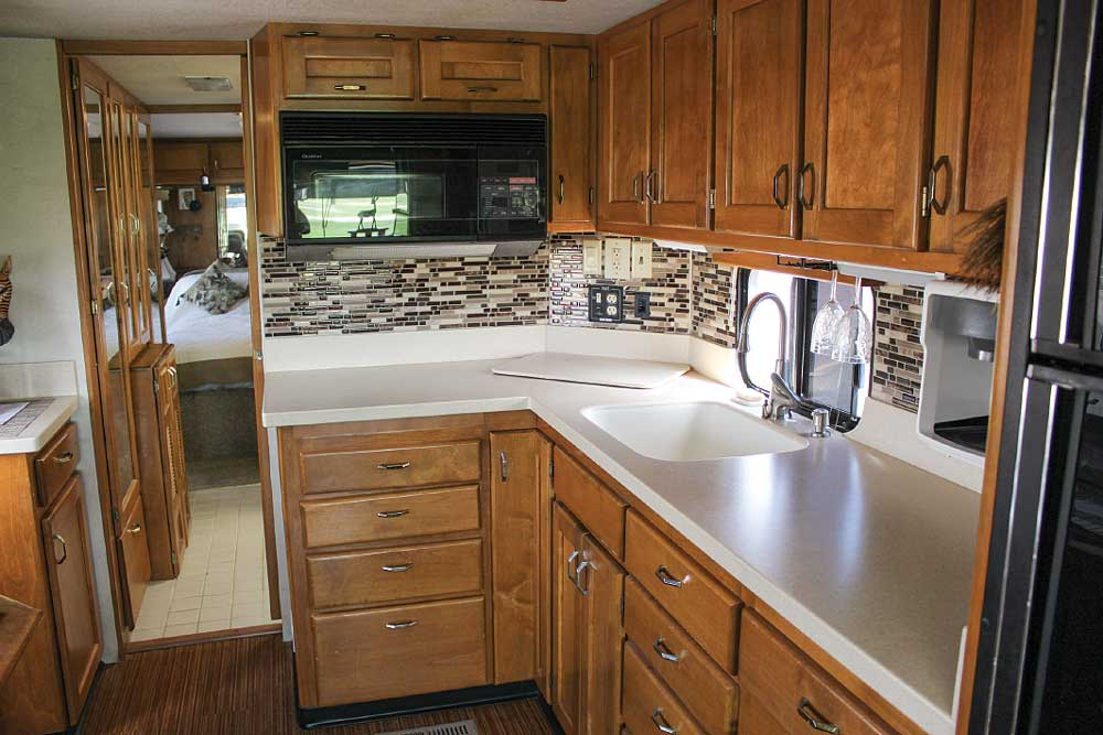 New solid-surface counters and tile backsplash, along with a laminate bamboo floor, update the Ivory's galley.