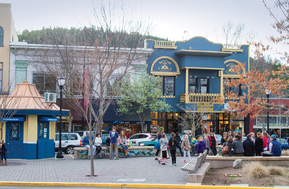 Residents and visitors alike gather in a downtown Ashland square.