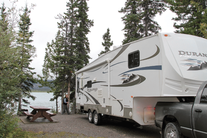 At British Columbia's Muncho Lake Provincial Park, RVers lay claim to a lakeside site at Strawberry Flats Campground.