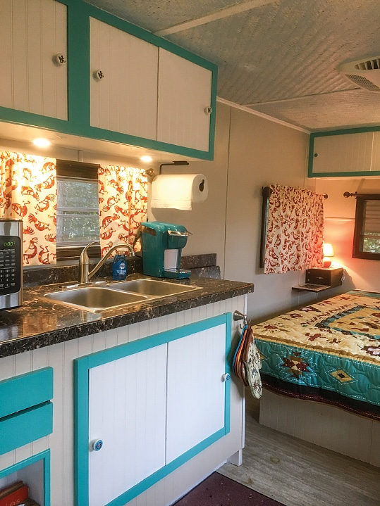 Even though the owners cook most of their meals outdoors, the well-thought-out kitchen is a functional and comfortable layout for year-round living and matches the look of the rest of the trailer.