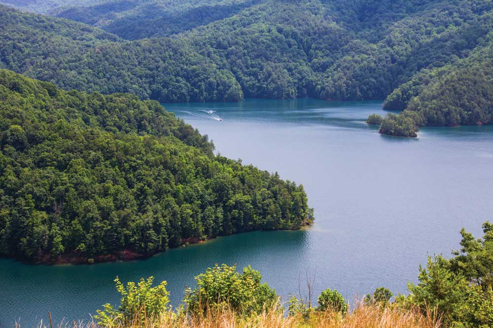 Secluded Lake Jocassee is noted for its clear, cold waters, fine mountain views, and for its fishing and water activities.