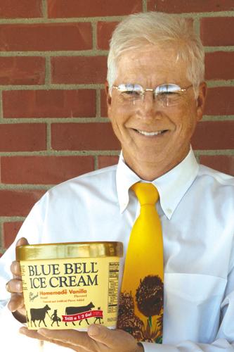 Older man wearing glasses holding Blue Bell Ice Cream