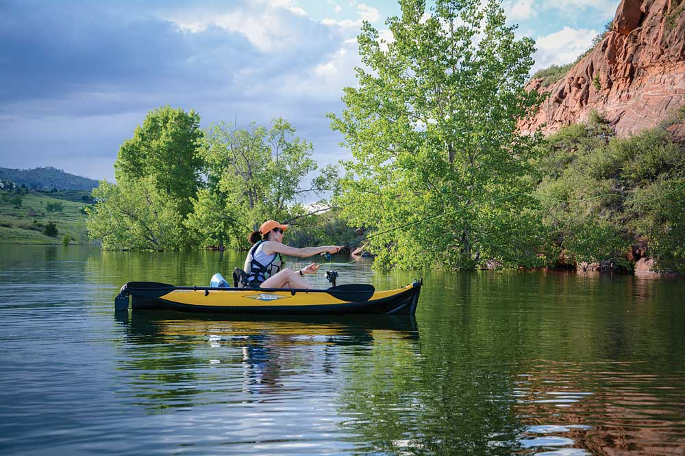 A woman fishing from a kayak
