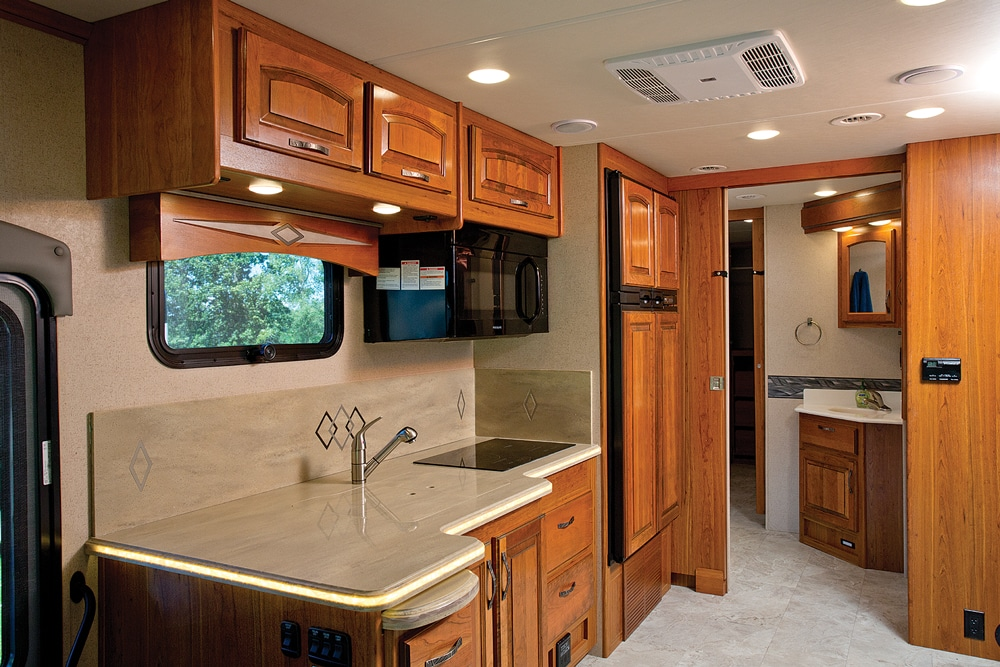 Galley is not overly roomy, but sink covers and the pullout countertop extension help the cook spread out.