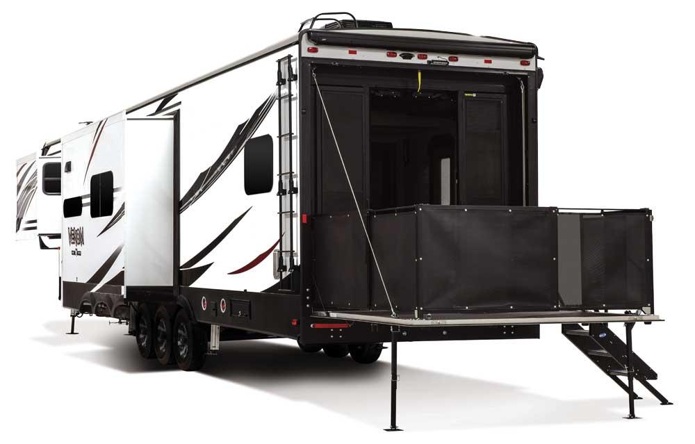 KZ RV Venom Fifth Wheel toy hauler with garage door open as patio