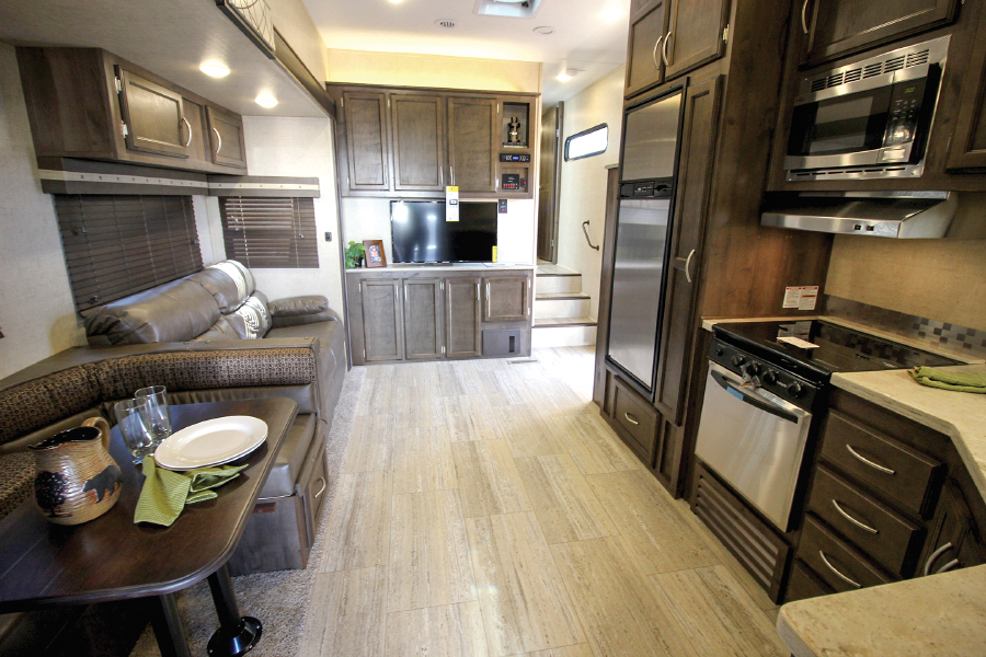 RV living space with table couch and microwave
