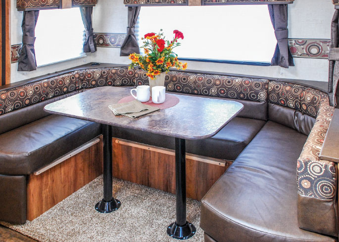 The dinette easily accommodates a family of five. At bedtime, it breaks down to sleeping quarters for one adult or two kids.