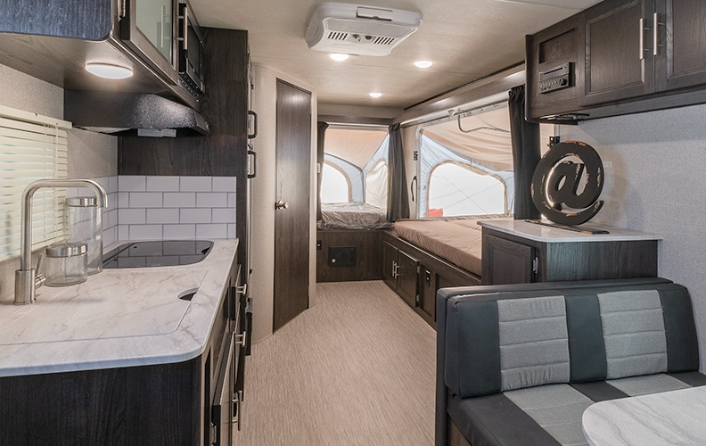 Two tent beds are extended in the rear of the trailer.