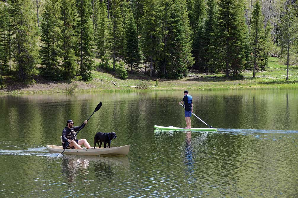 Kayakers and SUPers enjoy a sunny day paddling on Pearl Lake near Steamboat Springs.