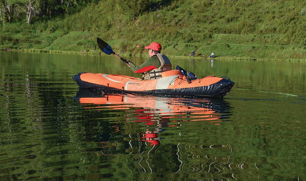 Kayaker on a lake in an inflatable kayak