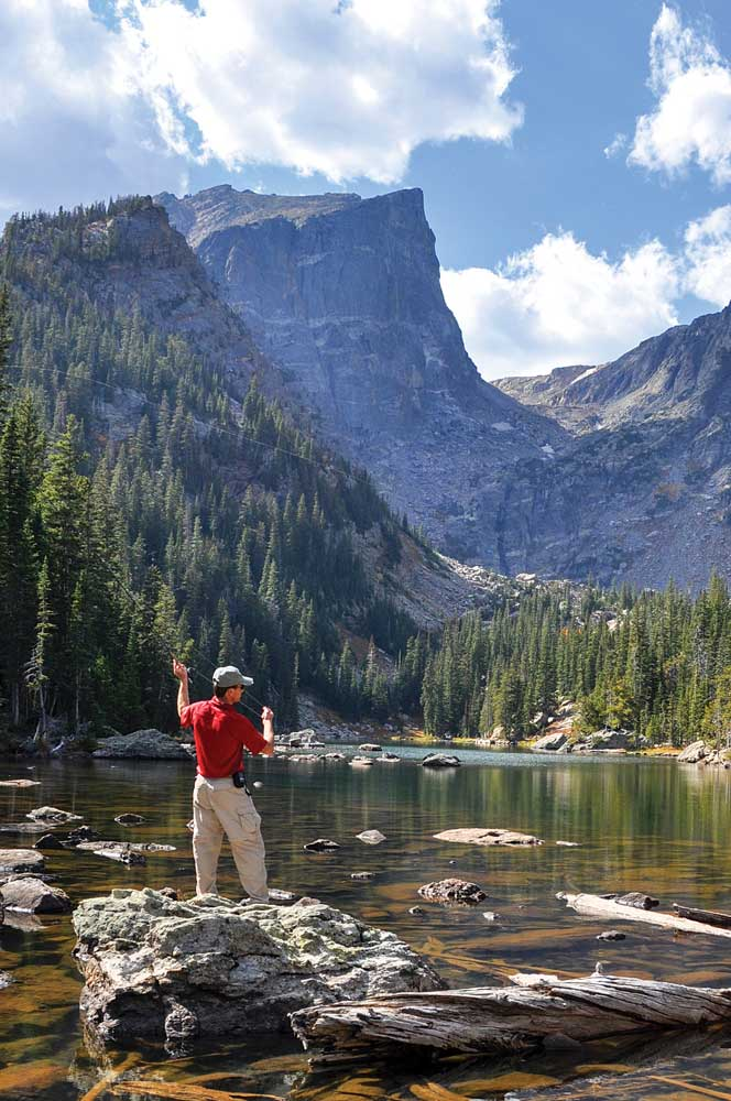 n angler casts for rare greenback cutthroat trout in Dream Lake.
