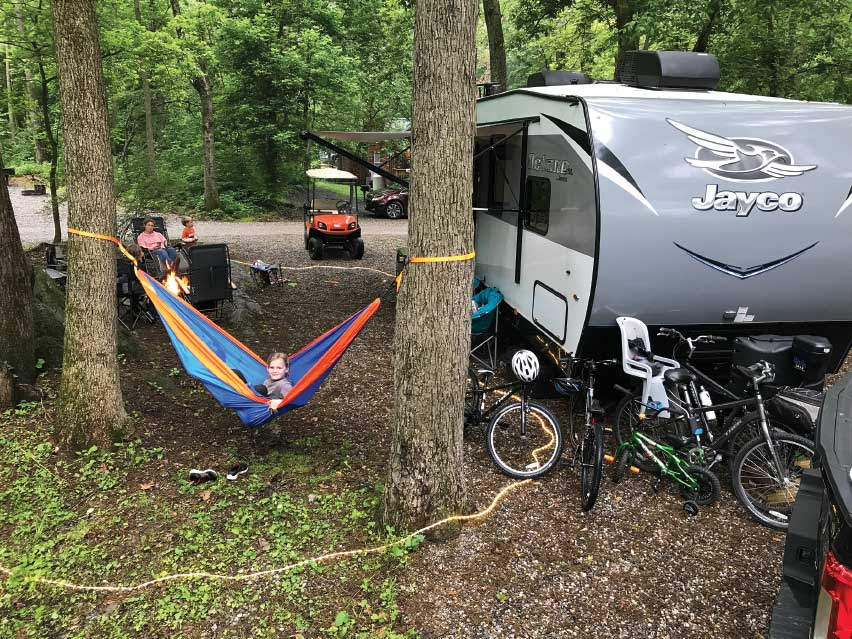 Jayco silver trailer at campground with hammock between trees