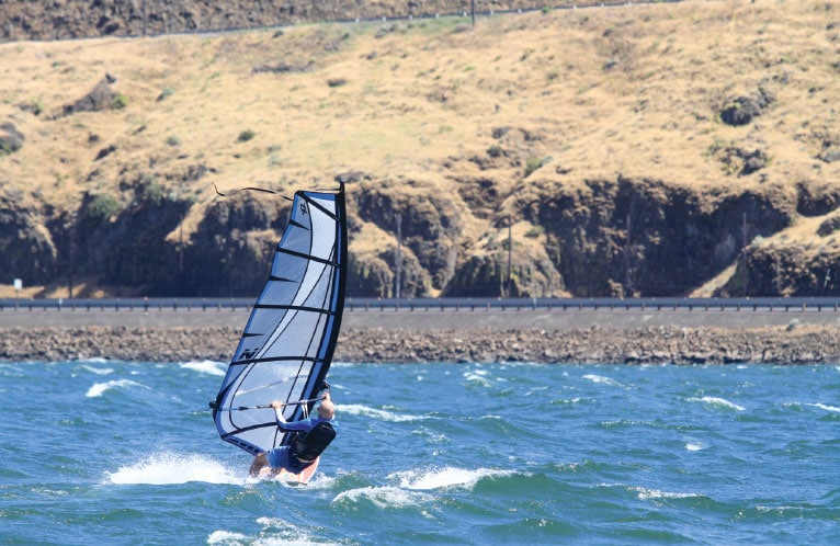 A wind-surfer plies the currents off the beach at Washington's Maryhill State Park.