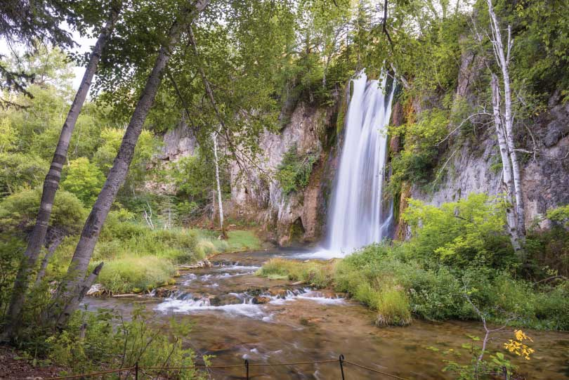 blurred waterfall emphasises movement using slow shutter speed