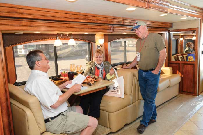 Don't let other shoppers deter you from fully inspecting an RV. Sit on all the furniture, pretend to make a meal in the kitchen, stand in the shower and lie on the bed. Ask a sales rep to bring in the slides to see what the rig is like in travel mode.