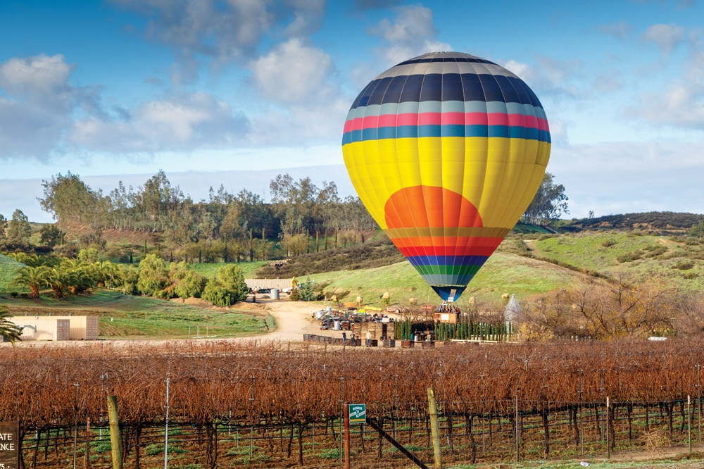 An early morning hot air balloon flight over the vineyards is a great way to start your wine-tasting weekend.