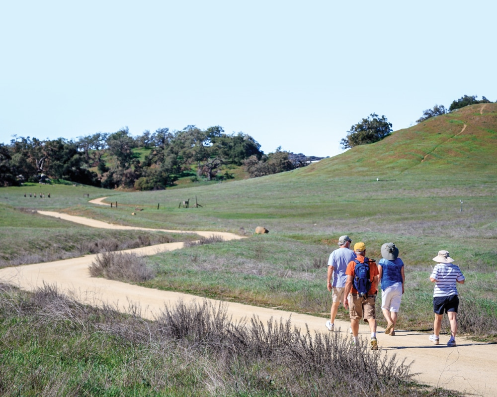 Hikers enjoy a leisurely trek in the Santa Rosa Plateau Ecological Reserve. Bicycling, horseback riding and dog walking are welcome in a separate multiuse area.