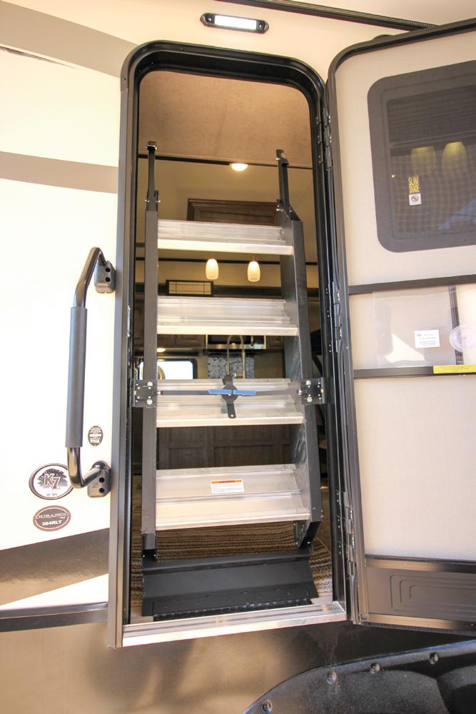RV door showing stairs