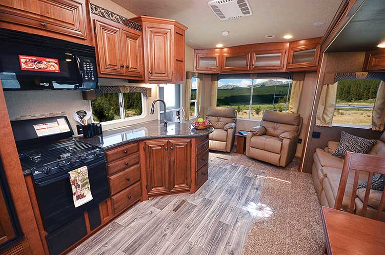 Living and kitchen area of Northwood Arctic Fox 29-5T RV