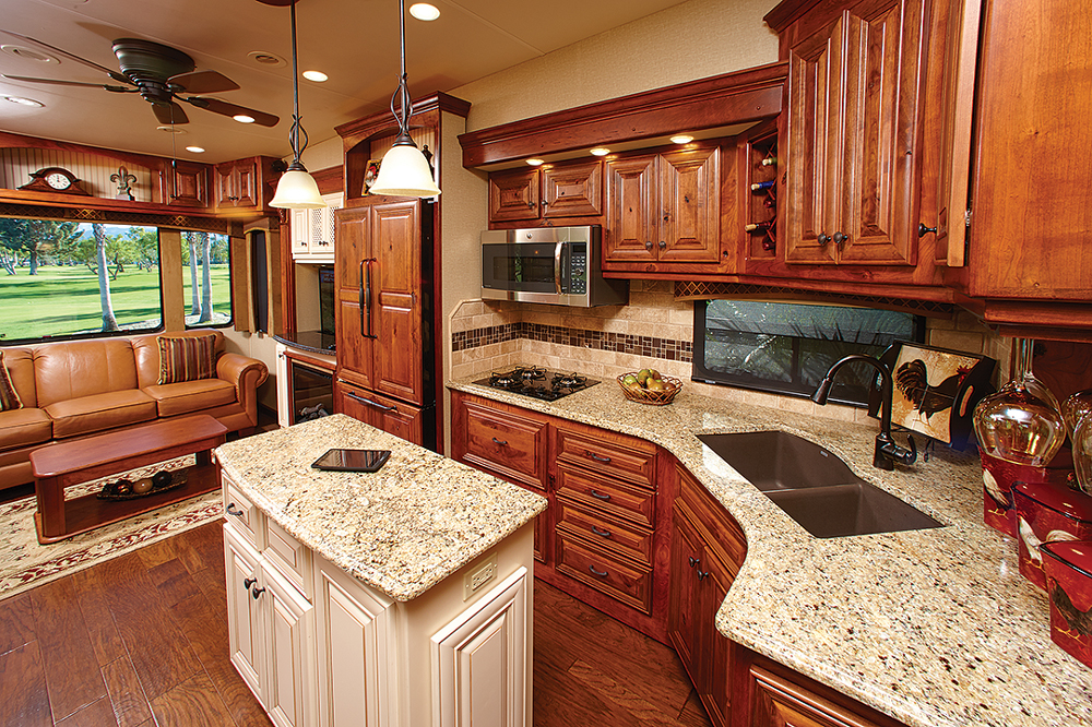 No expense was spared in the kitchen, which features granite countertops, solid cabinetry, a tumbled marble backsplash and a Blanco sink with oil-rubbed bronze fixtures.