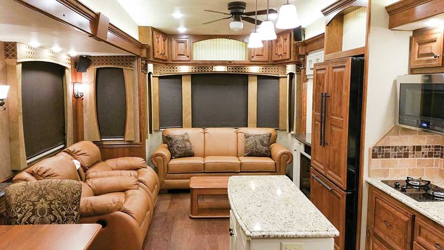 Beautiful living area with leather couches inside RV