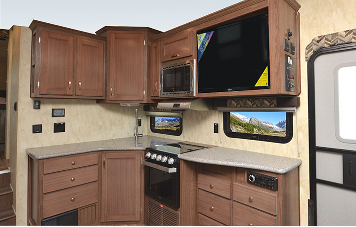 Kitchen cabinets, microwave and oven in Northwood Fox Mountain 265RDS fifth-wheel