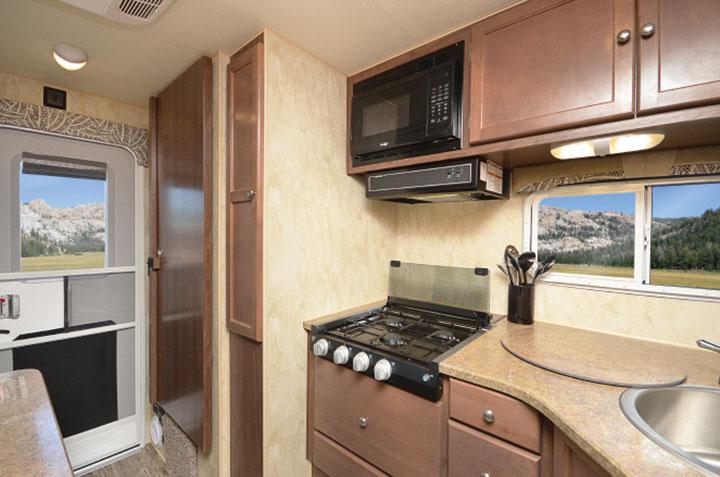 Interior kitchen and entry door of Northwood Wolf Creek 850 truck camper