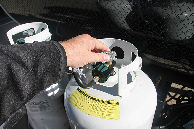 Service valves on DOT cylinders have three-sided handwheels and OPD safety devices that prevent overfilling.