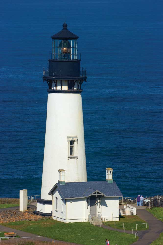 Yaquina Head Lighthouse towers above the Oregon coast in the Newport area.