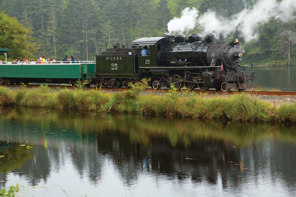 Steam rises from the Oregon Coast Scenic Railroad locomotive while transporting visitors between Garibaldi and Rockaway Beach along tracks that once ran timber in the area.